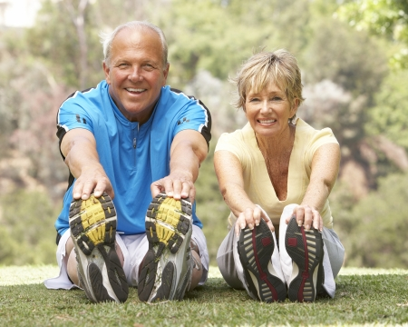 bigstock-Senior-Couple-Exercising-In-Pa-13911026