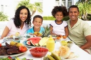 ethnic family having dinner together