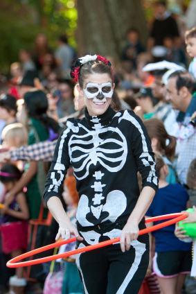 Female Skeleton Does Hula Hoop At Halloween Parade