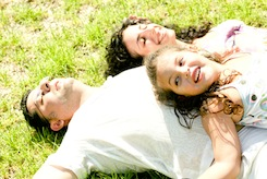 Couple lying down with daughter