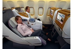 """Enjoying a 22"""" touch screen TV with a full reclining chair."""