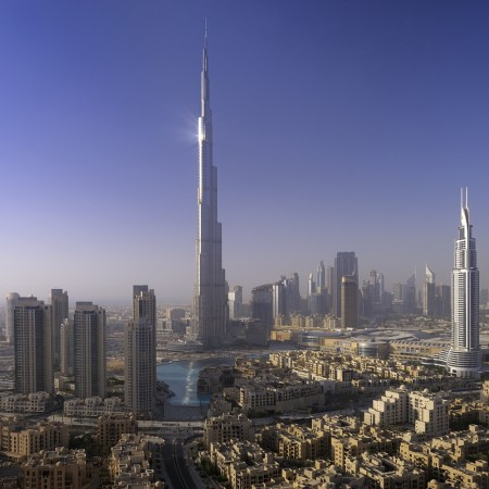 The city of Dubai with the Burj Khalifa in the forefront, gleams and sparkles with buildings of glass and steel that soar, lean, bulge, twist and fold, often appearing to defy gravity.