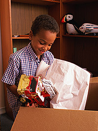 Boy packing toy fire truck