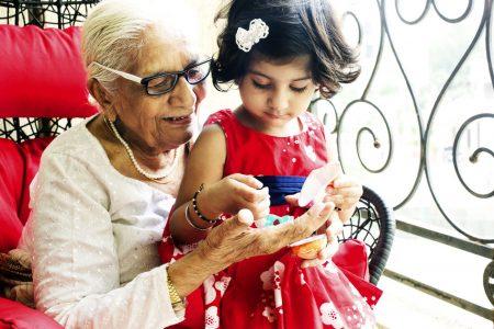 yowoto-indian-toddler-girl-playing-with-grandmother