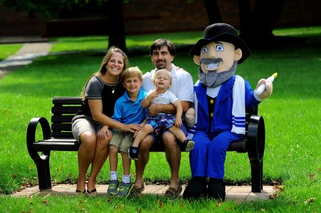 Neal with family and the original Mensch on a Bench
