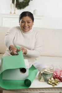 bigstock-senior-hispanic-woman-wrapping-32391779-370x554