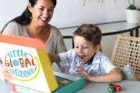 boy opening Little Global Citizens box